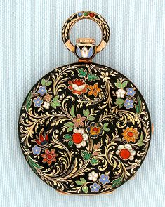 Fine and lovely Swiss 18K gold and champlevee and cloisoinee enamel antique keywind ladies pendant watch by Aubert & Capt, Geneva, circa 1830. The case with beautiful gold folliage and colored enamel flowers against a black background. Silver engine turned dial with gold Breguet hands. Gilt 6 jewel cylinder movement.