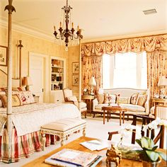 A beautiful french inspired bedroom comfortably mixes florals, plaids and stripes, designed by Charles Faudree.