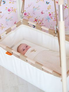 Hanging baby cradle on a spring from natural by Hangingcradles
