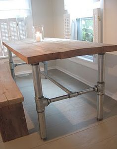 Super simple, light industrial looking table / base.  Easy to source these materials.  Can get inexpensive butcher block tops at IKEA.  The galvanized plumbing pipe & fittings are available at local plumbing supply house (if not Home Depot / Lowes).