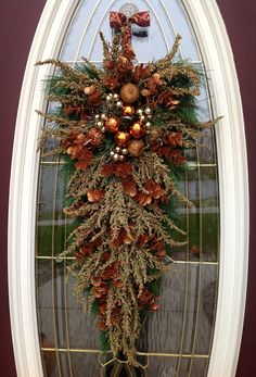 "Christmas Wreath Holiday Door Wreath Teardrop Swag Decor..""Copper Christmas"". $70.00, via Etsy."
