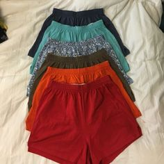 Soffe short bundle ‼️‼️ Lot of heather blue, turquoise, blue with brown & white dots/circles, brown, orange & red.  (6 pairs ‼️‼️).  Very few flaws (missing tags, the red ones slit on the right side is ripping). Soffe Shorts