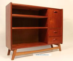 mid century modern bookcase in teak with two drawers and glass sliding
