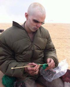 """@NicholasHoult Trying to get work done on #furyroad set #knitlife https://www.instagram.com/p/BTbYXXMgU50/"""