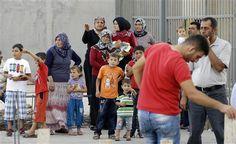 Refugiados sirios en el punto fronterizo turco de Cilvegozu el viernes 30 de agosto de 2013. @Barack Obama (Foto AP/Gregorio Borgia)