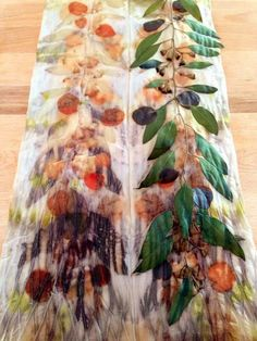 notjustnat creative blog-- 2 types of eucalyptus leaves on silk, wrapped tightly around a copper pipe and steamed for 1 hour, then left wrapped for a week.