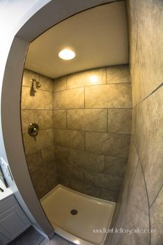 Grey tile shower for