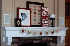 love the whole mantel, but i'm loving the frame with the hearts hanging from it.  i have a perfect frame for that!