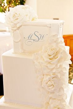 White square wedding cake with monogram. Gumpaste sugar flowers cascade down the side.  Polish Bakery & Hand-Crafted Cake Creations in Livonia, MI ::: GM Paris Bakery