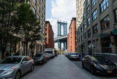 The Manhattan Bridge, framing the Empire State Building beneath, as seen from Washington Street. DUMBO. New York.