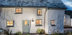 Nestling deep in the leafy Cornish countryside, this whitewashed stone cottage has been thoughtfully restored to bring out all of its original charm.