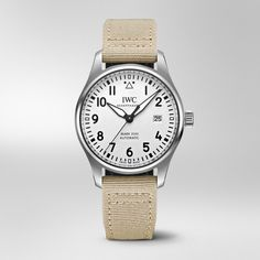 The beige textile strap is extremely comfortable to wear and lends a sporty touch to this Pilot's Watch Mark XVIII featuring a silver-plated dial and black hands. Iwc Watches, Watches For Men, Iwc Perpetual Calendar, Iwc Chronograph, Iwc Pilot, Watch Companies, Stainless Steel Bracelet, Omega Watch, Clocks