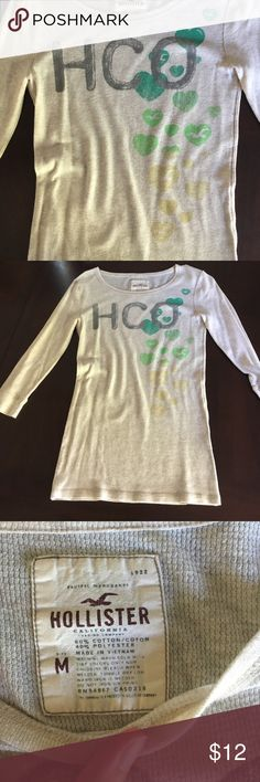Hollister 3/4 length sleeve Graphic Thermal Hollister Thermal three quarter length sleeves. Tan color with grey HCO and Ombré green to yellow hearts. Worn once.   🍍 Have questions? Please ask! 💚 I love offers! 🍍 I won't be offended when you lowball only if you won't be offended when I counter.  💚 Please use the offer button or my 'Closet Rules' thread to negotiate bundles. 🍍  Refer to my handy chart for guidance on offers. 💚 Bundle & save! Hollister Tops