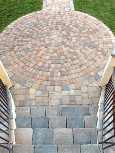 One great front walkway idea is to alternate ground cover between courses of pavers.: Front Walkway Ideas: Medallion Gives Path Illusion of Grandeur