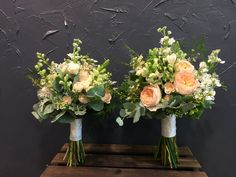 Adorable Bridal and Bridesmaid bouquets with O'hara roses, Sweet Avalanche roses, freesia, eucalyptus, silver leaves.