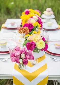 Chevron and pops of color with yellow and pink would pair perfectly with a little girl baby shower. 45 Awesome Colorful Wedding Table Settings | Weddingomania