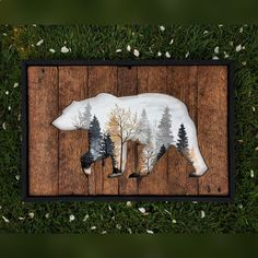 A beautiful piece created on reclaimed wood of a bear and within the cutout is a foggy Autumn morning. And to bring it all together, a crisp black frame. Measures at 16x24. Woodworking and painting all in one.