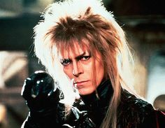 Movie: Labyrinth (1986)   This dark family film (directed by Jim Henson and produced by George Lucas) tells the epic story of   Sarah, played by Jennifer Connelly, who must rescue   her infant brother who has been kidnapped by the Goblin King Jareth. Set in a   bizarre, otherworldly maze, and starring a creepy David Bowie as Jareth, the film (watch clips) now has a cult   following.