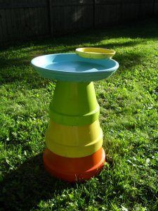 cool birdbath made from planters