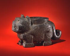 Andean Jaguar Effigy Mortar. Stone Jaguar effigy mortar, with cavity in back. Low relief carving. Andes, Chavin. by Penn Museum on Flickr.