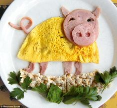 Playful: A ham-made pig sports a dress made from egg as he plays in a puddle of…