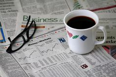Coffee and a Newspaper by Wildman 60D, via Flickr