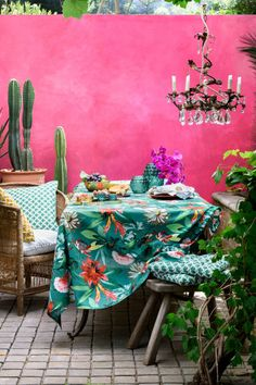 A colourful Morrocan style patio but it could equally work in a garden room Shocking Pink walls tropical print table cloth chandelier and indoor plants # Home Interior, Interior And Exterior, Interior Design, Outdoor Spaces, Outdoor Living, Mein Café, Indie Room, Interior Minimalista, H&m Home