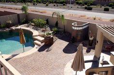 Elegant Arizona Desert Backyard, Yard and pool are introduced by seven stone pillars.  Large BBQ island with 5 burner grill fridge tankless ...