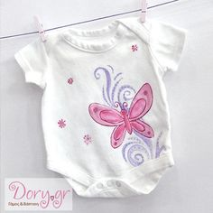 Hand painted baby onesie and adorned with Swarovski crystals