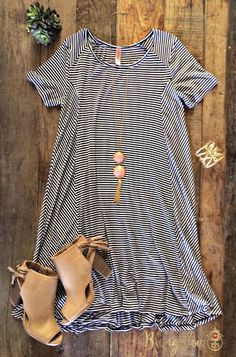 Basic striped tee dress that is ultra-comfortable and will never go out of style. A-line style. 95% Rayon 5% Spandex. This dress runs big, if in-between sizes, we recommend ordering the smaller of the