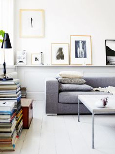 Bo Concept sofa and beautifully displayed artowrk and books. Johan Sellén