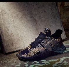 c7e0a883ef3 Undefeated X Adidas Originals Prophere Tiger Camo Core Black Trace Olive  Raw Gold shoe fit Sneaker
