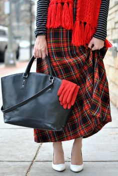 I like the pairing of the striped top with the tartan skirt
