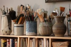Pottery as paintbrush holders.