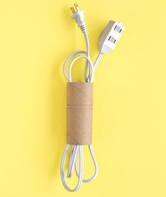 The cardboard tube from a spent roll of toilet tissue is a wonderfully simple tool for keeping extension cords tangle-free.