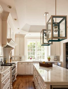 Holly Hollingsworth Phillips - Design Chic - gorgeous white kitchen - love the wood floors and the lanterns…fabulous!