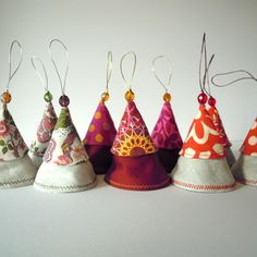 Cool cones tree decorations :: These are similar to some bells I did years ago:  mine are more irregular/have rough edges, irreg. bell ringers hang on thin, twine-like cord.  ***Reminder to make ~ if time permits!***