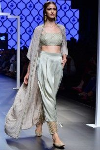 Featuring a grey bustier in silk base with embroidered fan motifs. It is paired with a matching low crotch pants in silk base with embroidered jaali at the bottom and georgette mukaish cape with embroidered scallops . Designer Party Wear Dresses, Indian Designer Outfits, Stylish Dress Designs, Stylish Dresses, Fashion Dresses, Indian Dresses, Indian Outfits, Mehendi Outfits, Bollywood Designer Sarees