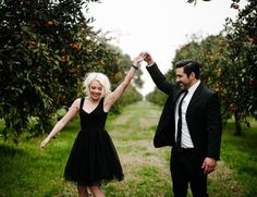 formal wear in an orange grove for an engagement session