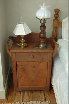 """Antique 19th century side table with lamps. Peg construction on drawers Possibly American and measuring 27"""" x 14"""" x 33"""""""