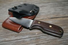 """Custom 'Squirt' model small EDC knife. 1084 High carbon steel w/ Black walnut scales & a custom kydex sheath. Designed with daily use in mind, the 2"""" blade and less than 5"""" total length with sheath of these knives is made to be small but amazingly useful. The large finger choil keeps the knife locked in you hand while using.  Check out my other work and see what's for sale. Message with any questions: http://www.facebook.com/JaredKramerStudios http://www.etsy.com/shop/JaredKramerStudios"""