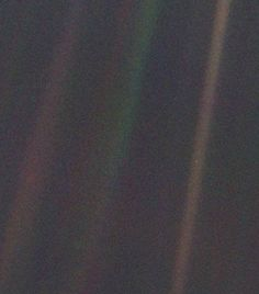 Pale Blue Dot On first impressions this image may look fairly indistinct, but in reality it is perhaps one of the most important photographs ever taken. The tiny blue-white dot, halfway down the brown streak on the right is actually our home planet, the Earth, floating in the dark depths of space, photographed by NASA's Voyager 1 spacecraft in 1990 from a record distance of 3.7 billion miles. Astronomer Carl Sagan requested that the picture be taken, and he subsequently reflected that 'all…