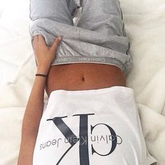 A California Girl's cuddle weather outfit: Calvin Klein t-shirt with loose sweat pants.