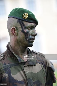 A legionnaire stands on June 17, 2016 in the La Cavalerie military camp southern France. As of June 29, 2016 the French Foreign Legion settles in La Cavalerie military camp on the Larzac plateau, expecting 13,000 legionnaires by 2018. / AFP / SYLVAIN