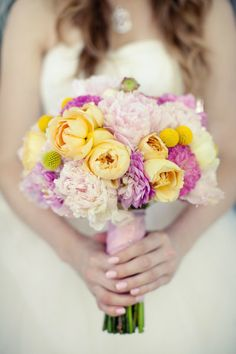 yellow peonies, soft pink peonies, purple dahlias and yellow buttons. a pretty perfect combo