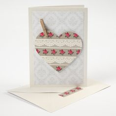 Vivi Gade Design Paper is glued onto a greeting card using double-sided adhesive tape. Masking tape is attached to a punched out heart which is attached to the card with 3D foam pads.