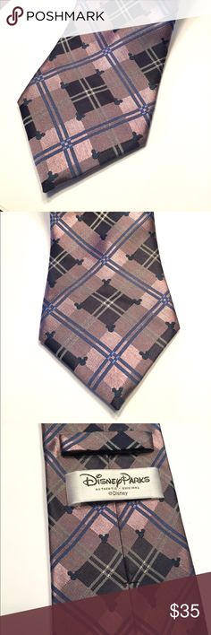 """WALT DISNEY PARKS HIDDEN MICKEY MOUSE PLAID TIE AUTHENTIC DISNEY PARKS - WALT DISNEY WORLD """" HIDDEN MICKEY MOUSE """" TIE  COLOR:PURPLE AND BLUE PLAID  100 % SILK  CONDITION: LIKE NEW! EXCELLENT USED CONDITION - NO STAINS, RIPS OR PULLS  SHIPS WITHIN 24 HOURS  PET FREE AND SMOKE FREE HOME!  ASK ANY QUESTIONS.. Disney Accessories Ties"""