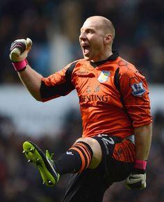 Getting his kicks: Villa keeper Brad Guzan celebrates as they take the lead against Liverpool