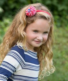 Pompom Headband - A pompom with a button is a sweet, crafty addition to a child's headband. Make one in every color for a fun way to accessorize!