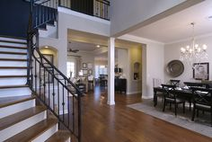 Regency Homebuilders : Dining Room, Neutral, Chandelier, Hand Scraped Hardwood, Arched Openings, Open Concept Living {White Oak Subdivision - Magnolia Plan}